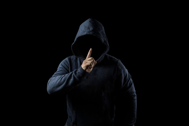 mysterious-unknown-person-hood-danger-darkness-anonymous-criminal-concept_1205-5268